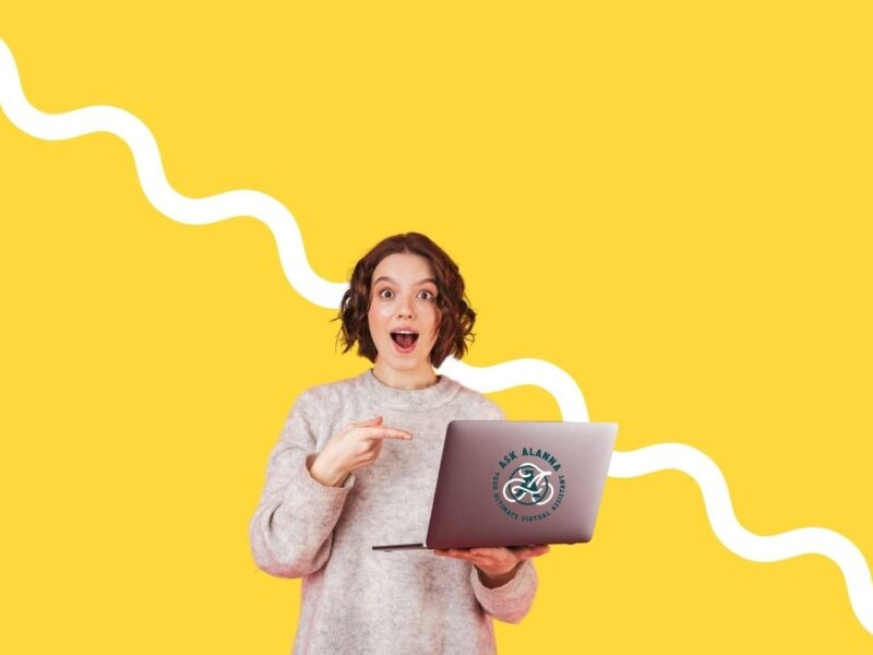 yellow background. foreground woman holding a laptop with the Ask Alanna logo on it, pointing to the laptop. Ask Alanna.
